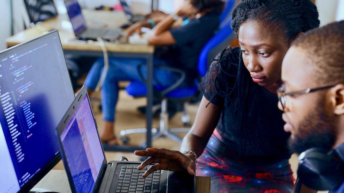 digital entrepreneurs look at a computer screen