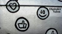 Emojis auf Wand gesprayt