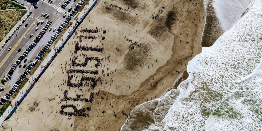 Resist written in the sand on a beach
